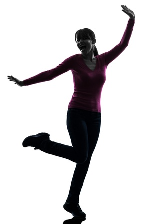 one caucasian woman happy stretching   in silhouette studio isolated on white background photo