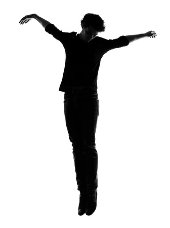 levitate: young man silhouette in studio isolated on white background