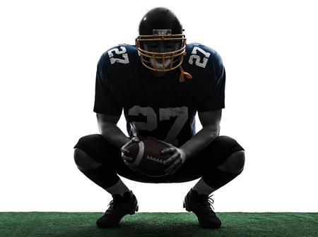 fuball spieler: ein caucasian american football player Mann in Silhouette Studio isoliert auf wei�em Hintergrund