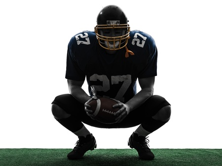 football player: one caucasian american football player man in silhouette studio isolated on white background
