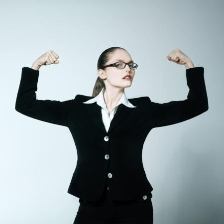 proud: studio shot portrait of one caucasian young woman  feeling strong Stock Photo