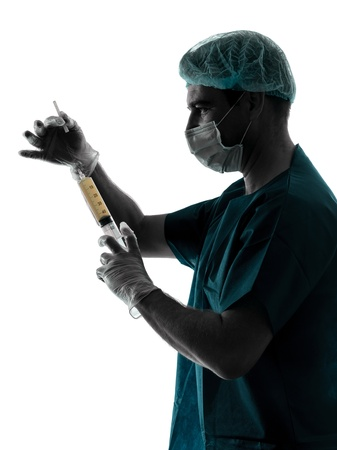 one caucasian doctor suegon  Anesthetist man holding surgery needle  silhouette isolated on white background photo