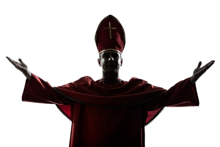 blessing: one man cardinal bishop silhouette saluting blessing in studio isolated on white background