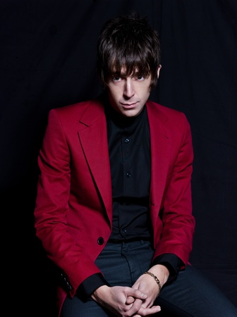 PARIS, FRANCE - FEBRUARY 03, 2012  Portrait of the british indie rock singer Miles Kane on studio black background at Paris, France on february 3rd, 2012