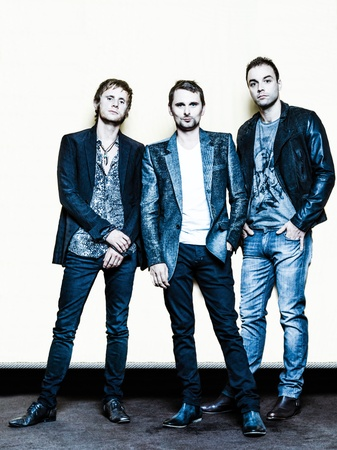 PARIS, FRANCE - JULY 04, 2012  Portrait of the english rock group Muse with  Matthew Bellamy, Dominic Howard and Christopher Wolstenholme at Paris, France on july 4th, 2012