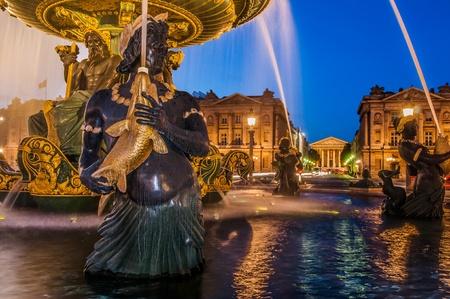 paris night: place de la concorde foutain in the city of Paris in france