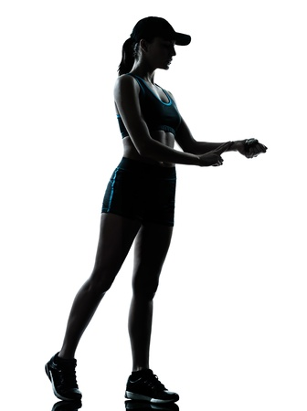heartrate: one caucasian woman runner jogger in silhouette studio isolated on white background