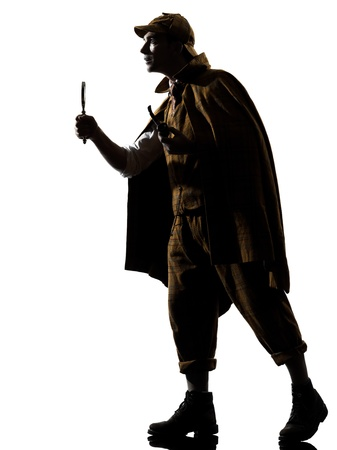 investigating: sherlock holmes silhouette in studio on white background