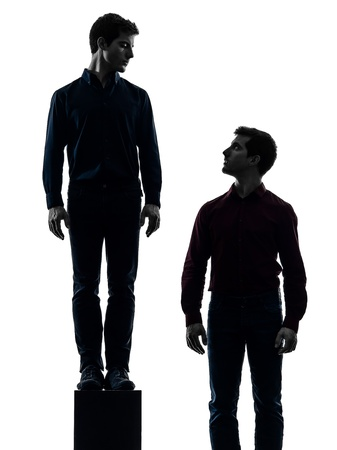 self respect: two caucasian young men dominant concept shadow  white background Stock Photo