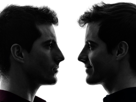 man face profile: close up portrait  two caucasian young men in shadow  white background