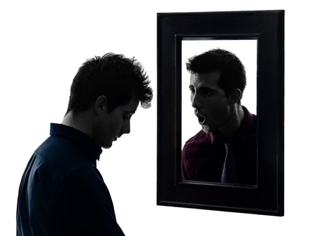 desperate face: man in front of his mirror  in shadow  white background