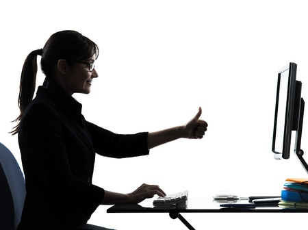 approval: one business woman computer computing thumb up satisfied   silhouette studio isolated on white background