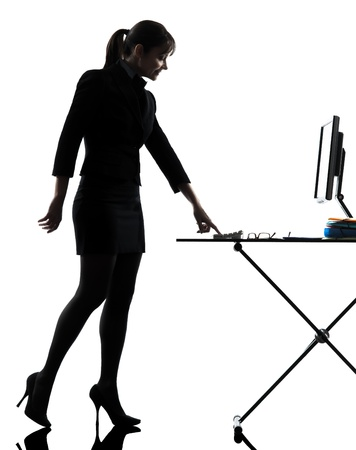 one business woman ignit g computer computing    silhouette studio isolated on white background photo