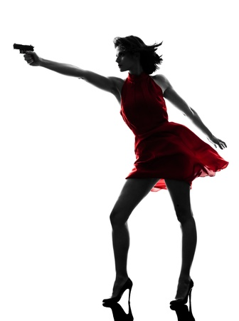 one sexy caucasian woman holding gun in silhouette studio isolated on white background Stock Photo - 18838131