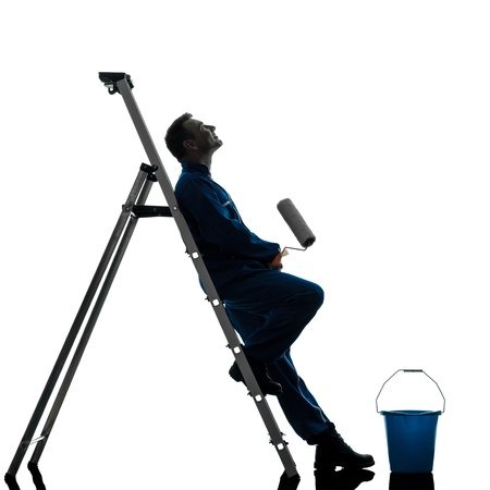 one caucasian man house painter worker silhouette in studio on white background Stock Photo - 18838119