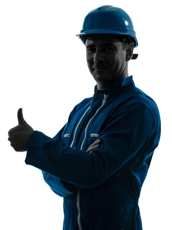shadow silhouette: one caucasian man construction worker Thumb Up smiling silhouette portrait in studio on white background