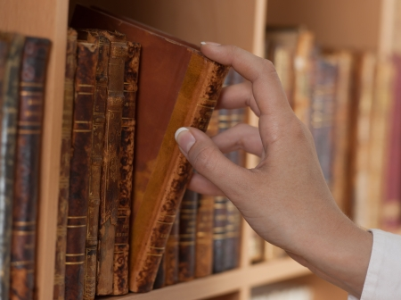 woman hand holding old book library close up photo