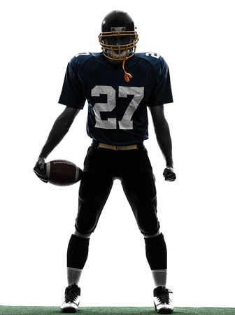 american football player: one caucasian quarterback american football player man in silhouette studio isolated on white background