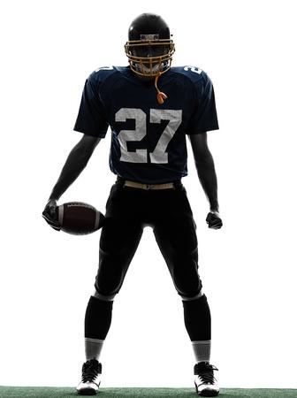 football silhouette: uno caucasico quarterback di football americano uomo giocatore in studio silhouette isolato su sfondo bianco