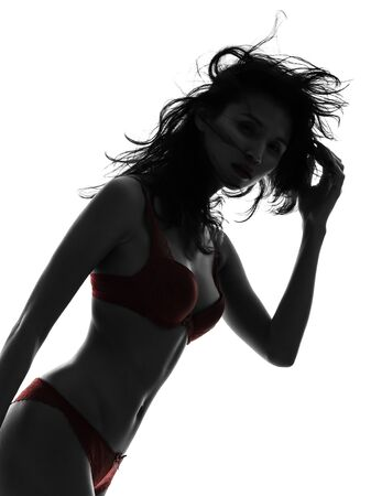 one beautiful asian woman  in red underwear  silhouette studio isolated on white background photo