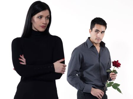 shy woman: amn offering a rose to a woman