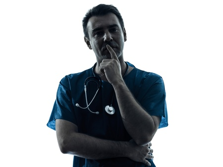 hesitancy: one caucasian man doctor surgeon medical worker  thinking pensive silhouette isolated on white background