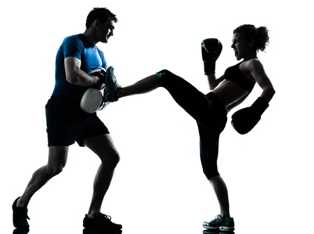 woman boxing gloves: one caucasian couple man woman personal trainer coach man woman boxing training silhouette studio isolated on white background Stock Photo