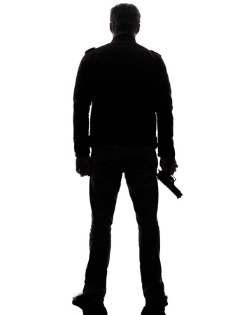 gangster with gun: one man killer policeman holding gun silhouette rear view studio white background