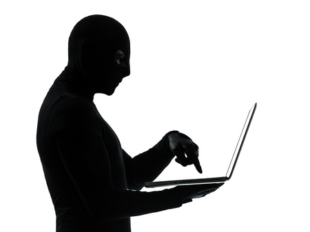 looting: thief criminal computer hacker  in silhouette studio isolated on white background
