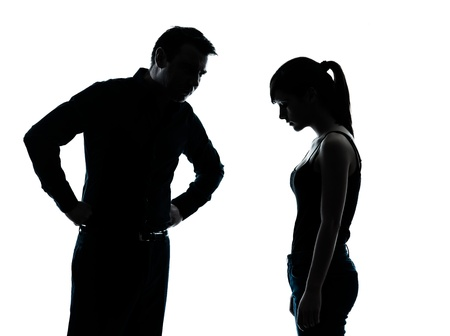 angry people: one man and teenager girl dispute conflict  in silhouette indoors isolated on white background