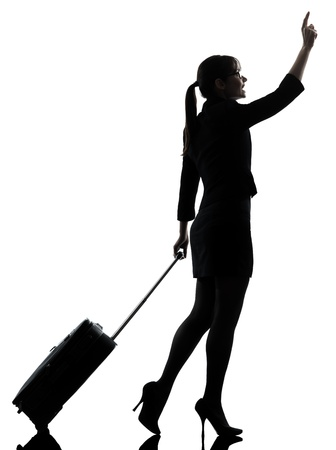 hailing: one business woman traveler walking hailing silhouette studio isolated on white background Stock Photo