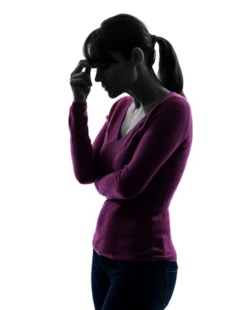 migraine: one caucasian woman migraine headache  in silhouette studio isolated on white background Stock Photo