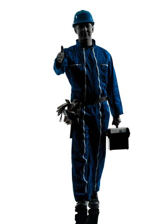 one caucasian repairman worker saluting silhouette in studio on white background photo