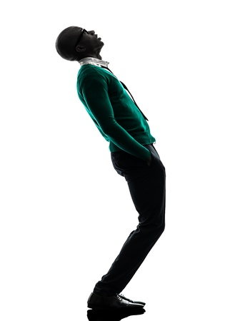 standing man: one african  black man standing looking up  surprised in silhouette studio on white background