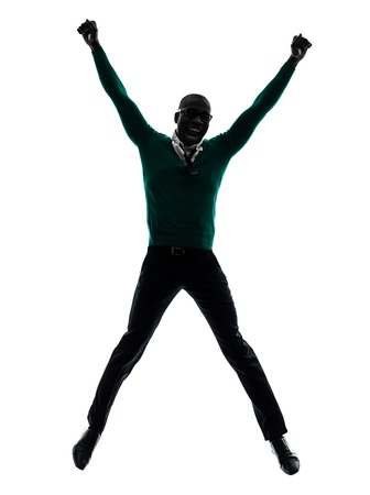 one african  black man  jumping happy  in silhouette studio on white background photo