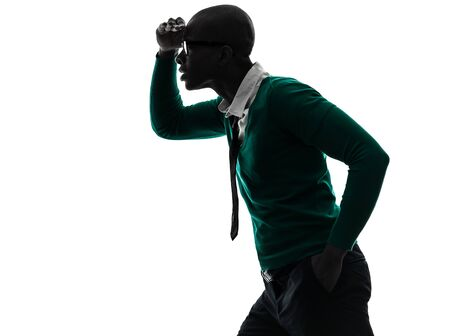 one african  black man looking away worried  in silhouette studio on white background photo