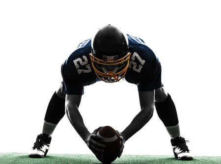 american football background: one center  american football player man in silhouette studio isolated on white background Stock Photo
