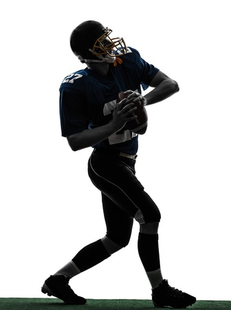 one caucasian quarterback american throwing football player man in silhouette studio isolated on white background Stock Photo - 19318368