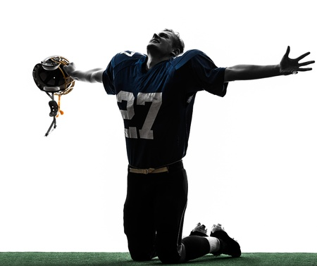 one caucasian american football player man triumphant in silhouette studio isolated on white background Stock Photo - 19318408
