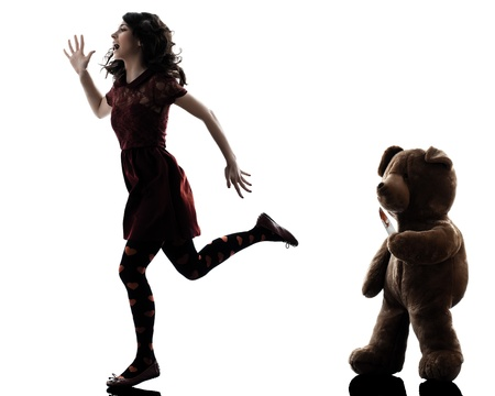 slasher: one caucasian strange young woman killer teddy bear  in silhouette white background