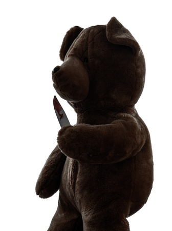 one  strange killer teddy bear holding bloody knife  in silhouette white background