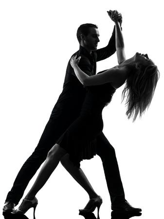 bailarina: um caucasiano mulher homem dan�ando salsa dan�arinos de rock no est�dio da silhueta isolado no fundo branco Banco de Imagens