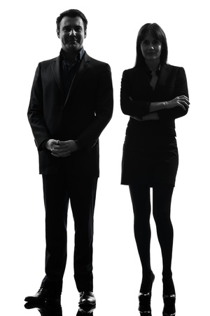 out of business: one caucasian couple business woman man in silhouette studio isolated on white background Stock Photo