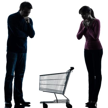 one caucasian couple woman man sad with empty shopping with shopping cart  in silhouette studio isolated on white background photo
