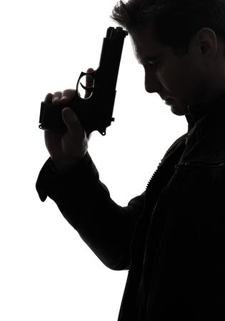 male killer: one man killer policeman holding gun portrait silhouette studio white background Stock Photo