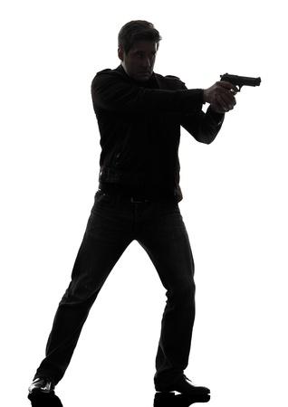 one man killer policeman aiming gun standing silhouette studio white background photo