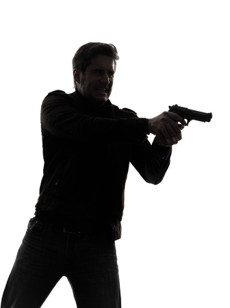 man with gun: one man killer policeman aiming gun portrait silhouette studio white background