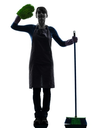 brooming: one caucasian woman maid saluting brooming   in silhouette studio isolated on white background