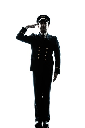 Salute: one caucasian man in airline pilot uniform saluting silhouette  in studio isolated on white background