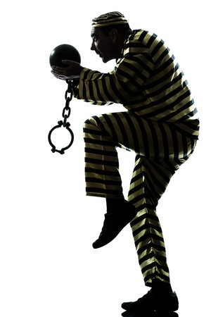 one caucasian man prisoner criminal escaping with chain ball in studio isolated on white background Stock Photo - 19318378